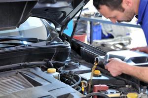 Man Adding Fluids to Car
